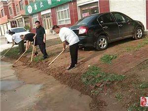 文旅局暴雨过后上街打扫卫生