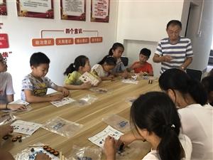 播下科�W�N子收�@科技����――和平村社�^�_展暑期青少年科普教育活��榧��