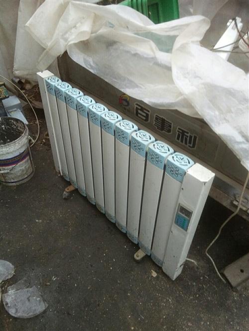 出售电暖气2台8成新价格美丽联系电话15732831896