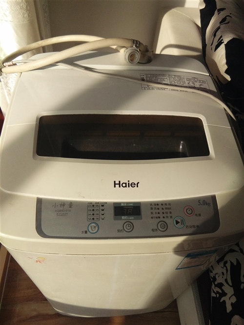海爾全自動洗衣機因搬家處理,5公斤的質量很好