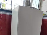 海尔燃气壁挂炉,采暖热水两用,九成新,联系电话13633587774