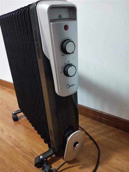 美的取暖器家用節能電暖油汀臥室暖氣片家用12片油丁烤火爐油酊 買了三年吧,總共用過不到十次。家里幾...