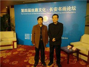 和陕西省政协文教委员会主任雷涛先生合影